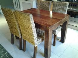 mango wood dining table next solid mango wood dining table and four next kobe rattan chairs