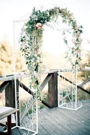 wedding arch greenery the arch but the flower decorations on it would prefer