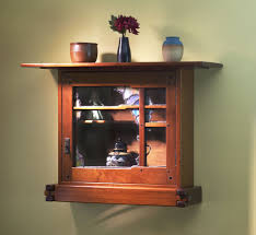 and greene wall cabinet with art glass