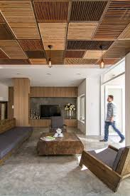 a patchwork of wood shutters cover the wall and ceiling in this