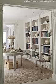 love the shaded sconces in between the shelving units family