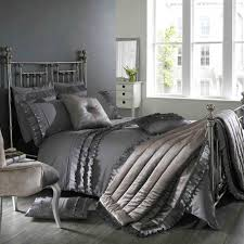 bedroom black and gray comforter with sham on grey bed frame with