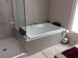 custom bathroom with shower bath combo heated floors and