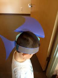 easy shark hats we made out of construction paper and tape kids