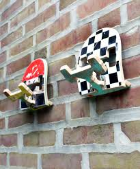 make your favorite broken skateboard into a funky furniture broken skateboard with chessboard design old skateboards with red lime green black colors in it and