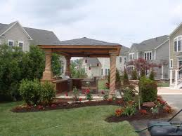 covered patio with contera columns and an integrated outdoor kitchen