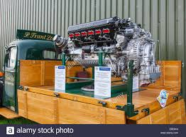 a classic vintage rolls royce merlin x aero engine on a stand at