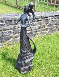 large contemporary sculptures embracing modern garden