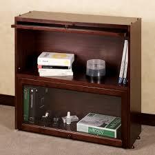 rectangular dark brown wood and glass bookshelf with short bases