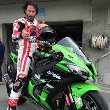 mazda moto avid track rider keanu reeves gives the ninja zx 10r the thumbs up