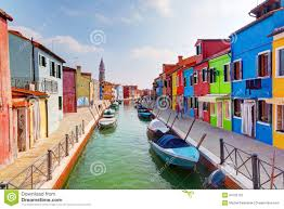 colorful houses and canal on burano island near venice italy