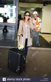 united luggage natalie imbruglia arrives with luggage and a goyard tote at lax