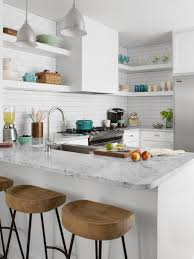 white kitchen cabinets granite countertops stainless steel knobs