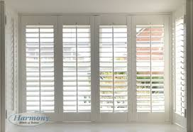 white shutters in a square bay window harmony blinds of bolton