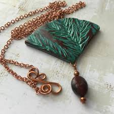 leaf pattern necklace earthy necklace with fan shaped polymer clay distressed focal