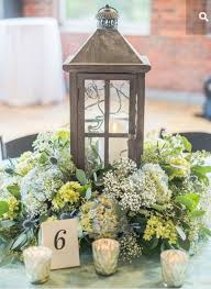flower surrounding lantern centerpieces u0026 table decor
