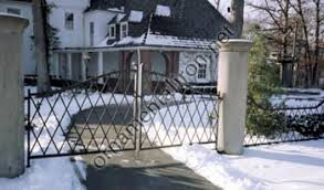 driveway gates with custom family crest made by mueller ornamental