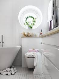 vintage tiny bathroom with bathtub curtains and white wainscoting