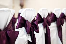 bows for chairs eggplant coloured bows on chairs at a reception the merry