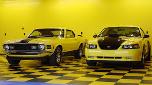 Mustang Yellow And Black A New And An Old Mustang With Matching Yellow Garage Racedeck