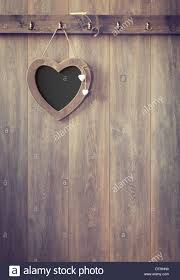 heart shape menu board hanging on wooden panel wall vintage tone