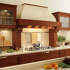 excellent oak wood cabinets flanking classic copper hood material most seen pictures in the outstanding range hood style ideas for modern kitchen design