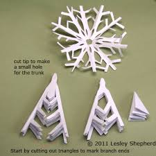 use paper snowflakes to make snowy winter trees paper snowflakes