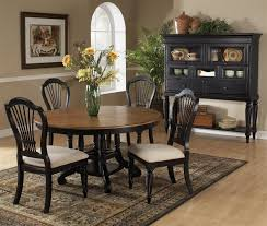 wilshire 5 piece round oval dining set in rubbed black and antique