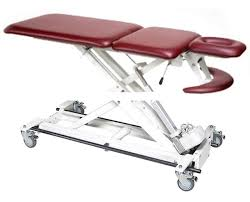 armedica hi lo treatment tables three section treatment table with bar activated height control