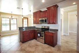 cherry maple kitchen with different wall height cabinets how to
