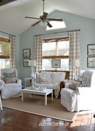 dining room window shutters vs blinds tan and white striped