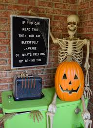 how to decorate your back porch for a halloween skeleton party