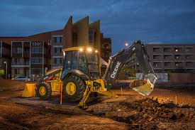 uplifting construction productivity with john deere backhoes