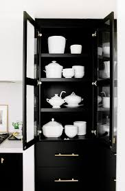 black built in china cabinet with brass hardware transitional