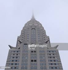 chrysler building and metal building ornament on a rainy day