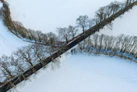 winter weather drone photos of the snow and ice in germany