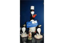 a carlton ware draught guinness penguin table lamp and three
