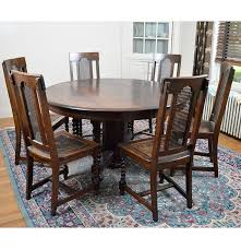 arts and crafts oak dining table with chairs circa 1900 ebth