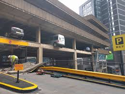 cars left dangling after multi storey car park collapses in