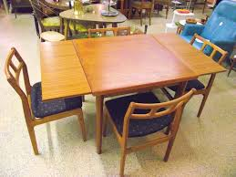 what is a draw leaf table denmark danish modern sculptural teak draw leaf table 4 chairs