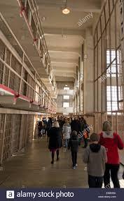 alcatraz tourist walk through the cell area listening to tour