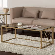 this stunning coffee table features a beautiful metal quatrefoil