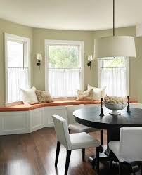 french cafe style dining room traditional with dark floor bench seat