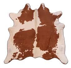 pouf en peau de vache peau de vache marron et blanc