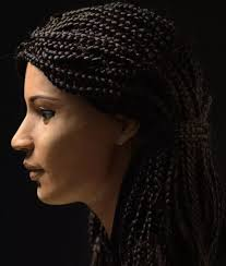 information on egyptain hairstlyes for and ancient egyptian woman s face who has been christened as