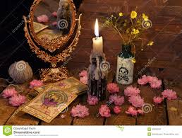 vintage still life with the tarot cards mirror flowers and