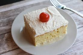 best tres leches cake three milk cake topped with whipped cream