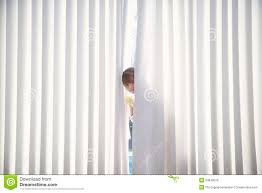 At Home Curtains Peeking From Curtains At Home Royalty Free Stock Image