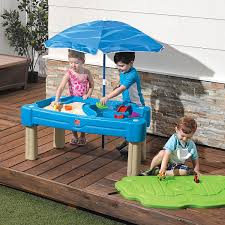 step 2 water table with umbrella amazon com step2 cascading cove sand and water table toys games