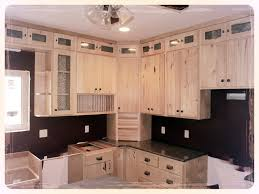 stone countertops rustic hickory kitchen cabinets lighting